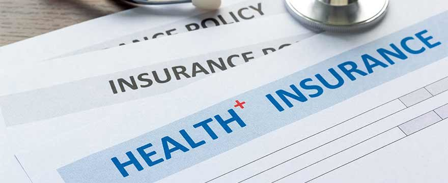 health insurance papers scattered on a desk.jpg