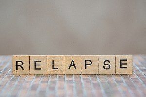 Relapse on wooden cubes. Outpatient programs are designed to treat substance addiction and addictive behaviors