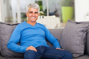 man on couch after going through a Medical Assisted Treatment