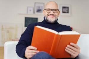 man in a Medical Assisted Treatment reading a book