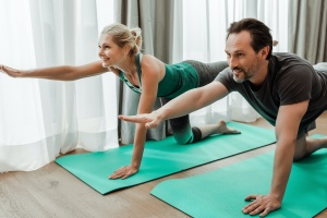couple doing yoga after he  Join An Intensive Outpatient Program