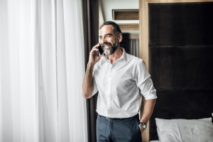 man calling to find out about How Long Is An Intensive Outpatient Program