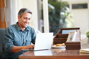 mature man looking up on his computer What Is An Intensive Outpatient Program